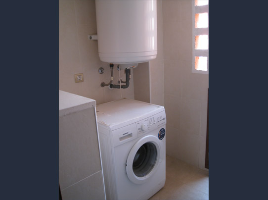 Washing machine and boiler in utility room
